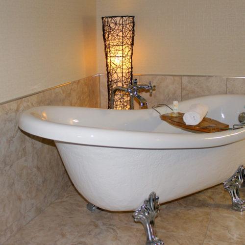 Chambre avec bain su pied, hôtel